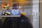 European Commission's chief negotiator Michel Barnier wears a face mask as he leaves his hotel to head back to Brussels, in London, Saturday, Dec. 5, 2020. With less than one month to go before the U.K. exits the EU's economic orbit, talks have been paused due to