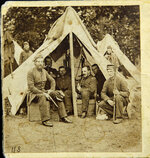This family photo, made in June 1861, shows Dr. Bowman Bigelow Breed, right inside tent with pipe. Breed, who served as a surgeon in the Union Army during the Civil War, was a member of the 8th Massachusetts Volunteer Militia, which was bivouacked in the U.S. Capitol Rotunda in the early days of the war. (Courtesy of the Breed Family via AP)