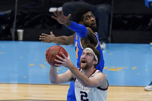 Gonzaga forward Drew Timme (2) drives to the basket ahead of UCLA forward Cody Riley, rear, during the first half of a men's Final Four NCAA college basketball tournament semifinal game, Saturday, April 3, 2021, at Lucas Oil Stadium in Indianapolis. (AP Photo/Darron Cummings)