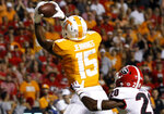 Tennessee wide receiver Jauan Jennings (15) pulls in a 12-yard touchdown pass against Georgia defensive back J.R. Reed (20) during an NCAA college football game Saturday, Oct. 5, 2019, in Knoxville, Tenn. (C.B. Schmelter/Chattanooga Times Free Press via AP)