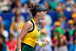 Australia's Ajla Tomljanovic yells after scoring a point against France's Pauline Parmentier during their Fed Cup tennis final in Perth, Australia, Sunday, Nov. 10, 2019. (AP Photo/Trevor Collens)