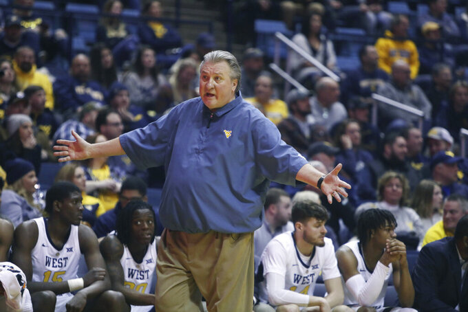 West Virginia head coach Bob Huggins yells at the referee during the first half of an NCAA college basketball game against Baylor Monday, Jan. 21, 2019, in Morgantown, W.Va. (AP Photo/Raymond Thompson)