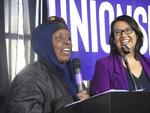 Miram Nur, left, who works as a janitor in the Twin Cities, rallies fellow union members alongside SEIU Local 26 President Iris Altamirano in Minneapolis on Saturday, Feb. 8, 2020. (Matt Sepic/Minnesota Public Radio via AP)