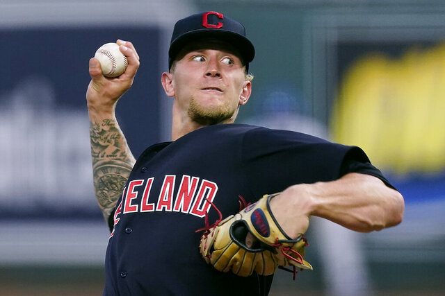 Cleveland Indians starting pitcher Zach Plesac throws during the first inning of a baseball game against the Kansas City Royals Tuesday, Sept. 1, 2020, in Kansas City, Mo. (AP Photo/Charlie Riedel)