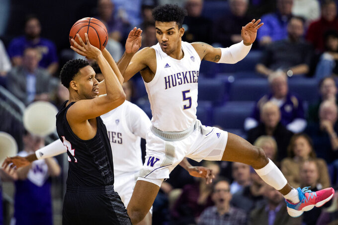 Washington guard Jamal Bey (5) guards Seattle guard Delante Jones (24) during the first half of an NCAA college basketball game, Tuesday, Dec. 17, 2019, in Seattle. (Andy Bao/The Seattle Times via AP)