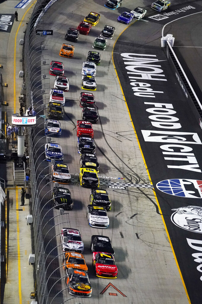 Noah Gragson (9) leads the pack at the start of a NASCAR Xfinity Series auto race at Bristol Motor Speedway Friday, Sept. 17, 2021, in Bristol, Tenn. (AP Photo/Mark Humphrey)