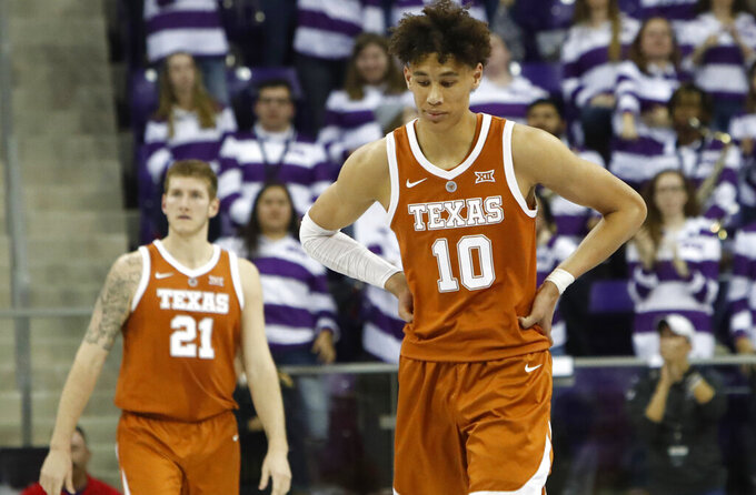 Texas forwards Jaxson Hayes (10) and Dylan Osetkowski (21) walk the court during the second half of an NCAA college basketball game against TCU in Fort Worth, Texas, Wednesday, Jan. 23, 2019. TCU won 65-61.(AP Photo/LM Otero)