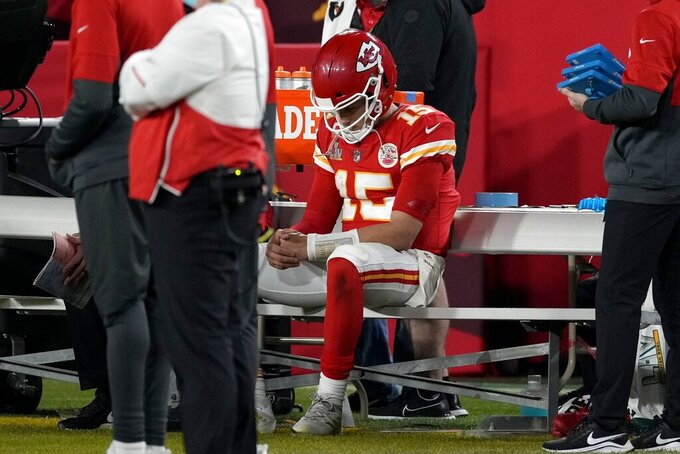 Kansas City Chiefs quarterback Patrick Mahomes sits on the bench during the second half of the NFL Super Bowl 55 football game against the Tampa Bay Buccaneers, Sunday, Feb. 7, 2021, in Tampa, Fla. (AP Photo/Chris O'Meara)