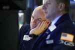 Specialist John O'Hara, left, works on the floor of the New York Stock Exchange, Friday, Jan. 11, 2019. Stocks are opening broadly lower on Wall Street, led by declines in banks and technology companies. (AP Photo/Richard Drew)
