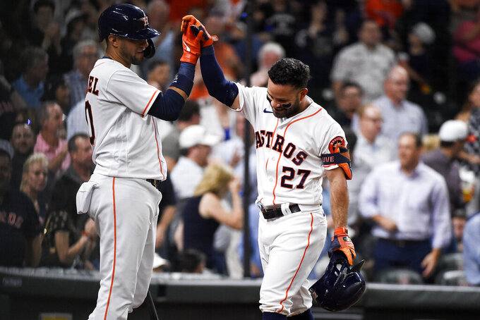 Houston Astros' Jose Altuve (27) celebrates his solo home run with Yuli Gurriel during the third inning of the team's baseball game against the Cleveland Indians, Tuesday, July 20, 2021, in Houston. (AP Photo/Eric Christian Smith)