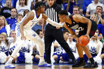 Mississippi State's Robert Woodard II, right, looks for an opening past Kentucky's Keion Brooks Jr. during the first half of an NCAA college basketball game in Lexington, Ky., Tuesday, Feb. 4, 2020. (AP Photo/James Crisp)