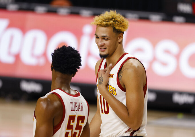 Iowa State forward Xavier Foster, right, jokes with guard Darlinstone Dubar, left, during a timeout in the second half of an NCAA college basketball game against Arkansas-Pine Bluff, Sunday, Nov. 29, 2020, in Ames, Iowa. (AP Photo/Matthew Putney)