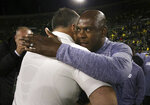 Colorado head coach Mel Tucker, right, embraces Oregon head coach Mario Cristobal after their NCAA college football game Friday, Oct. 11, 2019, in Eugene, Ore. Oregon won the game 45-3. (AP Photo/Chris Pietsch)