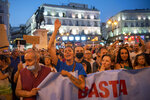 Demonstrators shout slogans during a protest in Puerta del Sol in Madrid, Spain, Saturday, Aug. 14, 2021. Protesters are rallying to show their opposition to vaccinating children against COVID-19. (AP Photo/Andrea Comas)