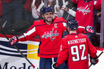 Washington Capitals left wing Alex Ovechkin (8) celebrates his first goal of the third period with center Evgeny Kuznetsov in an NHL hockey game, Wednesday, Oct. 13, 2021, in Washington. The Capitals won 5-1. (AP Photo/Alex Brandon)