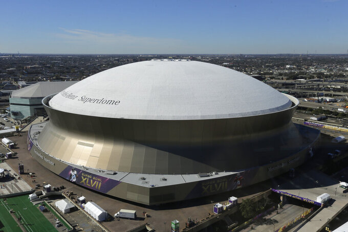 FILE - In this Thursday, Jan. 31, 2013 file photo, The Superdome, site of the NFL Super Bowl XLVII football game between the San Francisco 49ers and Baltimore Ravens is photographed from an office building in New Orleans. New Orleans' Superdome, the iconic domed stadium that is home to the Saints football team, will be getting a $450 million facelift before it hosts its next Super Bowl in 2024. Upgrades to the 44-year-old stadium are part of Gov. John Bel Edwards' ongoing negotiations with the NFL team, aimed at keeping the Saints in Louisiana another 30 years. (AP Photo/Charlie Riedel, File)