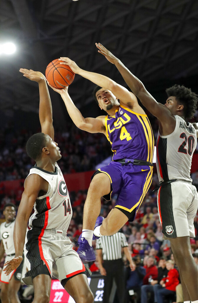 LSU guard Skylar Mays (4) goes between Georgia's Tye Fagan (14) and Rayshaun Hammonds (20) during the first half of an NCAA college basketball game Saturday, Feb. 16, 2019, in Athens, Ga. (AP Photo/John Bazemore)