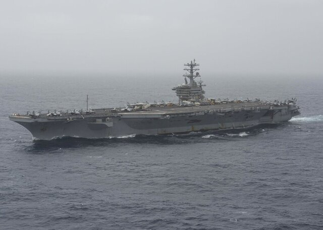 In this photo released by the U.S. Navy, the aircraft carrier USS Nimitz transits the Arabian Sea on Aug. 17, 2020. The U.S. Navy searched through the night into the morning of Monday, Sept. 7, 2020, for a sailor who went missing from the aircraft carrier USS Nimitz during its patrol of the northern Arabian Sea amid tensions with Iran. (Mass Communication Specialist 3rd Class Elliot Schaudt/U.S. Navy via AP)