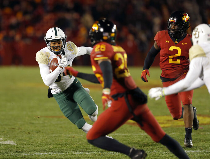 Baylor wide receiver Marques Jones, left, runs the ball during the second half of an NCAA college football game against Iowa State on Saturday, Nov. 10, 2018, in Ames, Iowa. Iowa State won 28-14. (AP Photo/Matthew Putney)