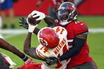 Tampa Bay Buccaneers inside linebacker Devin White (45) takes down Kansas City Chiefs wide receiver Sammy Watkins (14) after a reception during the first half of an NFL football game Sunday, Nov. 29, 2020, in Tampa, Fla. (AP Photo/Jason Behnken)