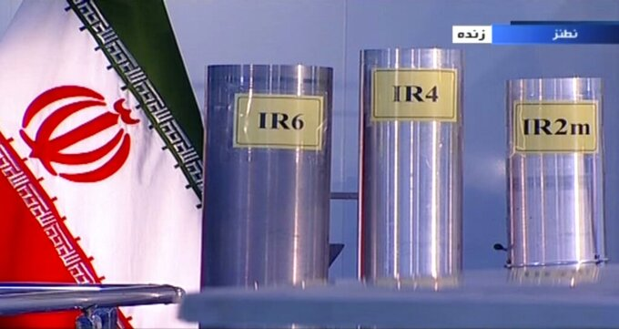 FILE - In this June 6, 2018 frame grab from the Islamic Republic Iran Broadcasting, IRIB, state-run TV, three versions of domestically-built centrifuges are shown in a live TV program from Natanz, an Iranian uranium enrichment plant, in Iran. Iran has not made a decision yet about whether to extend an agreement with the U.N. atomic watchdog over access to surveillance footage at its nuclear sites, the country's foreign ministry said Monday, June 28, 2021. (IRIB via AP, File)