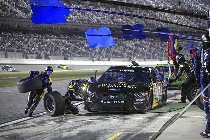 Cole Custer (41) makes a pit stop during a NASCAR Cup Series auto race at Daytona International Speedway, Saturday, Aug. 28, 2021, in Daytona Beach, Fla. (AP Photo/Phelan M. Ebenhack)