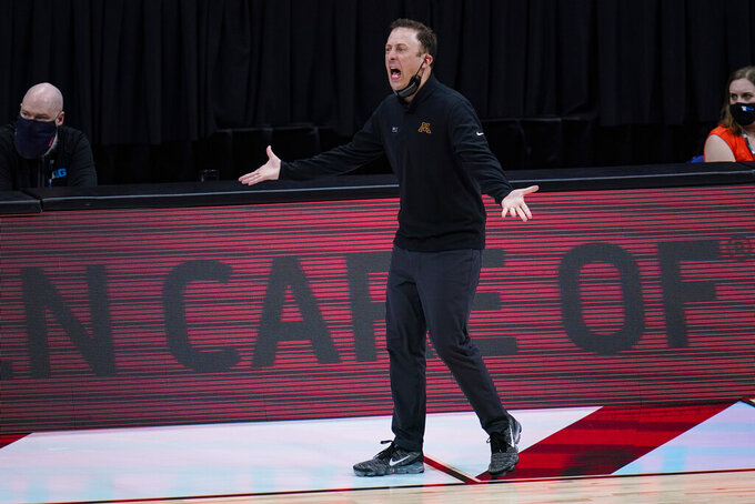 Minnesota head coach Richard Pitino questions a call as his team played against Ohio State in the first half of an NCAA college basketball game at the Big Ten Conference tournament in Indianapolis, Thursday, March 11, 2021. (AP Photo/Michael Conroy)