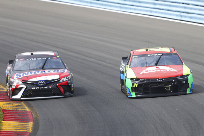 Kyle Busch, left, and William Byron, right, turn into the Esses during a NASCAR Cup Series auto race in Watkins Glen, N.Y., on Sunday, Aug. 8, 2021. (AP Photo/Joshua Bessex)