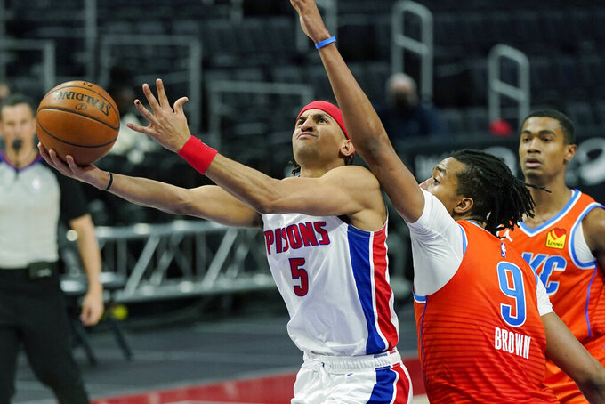 Detroit Pistons guard Frank Jackson (5) attempts a layup as Oklahoma City Thunder center Moses Brown (9) defends during the second half of an NBA basketball game, Friday, April 16, 2021, in Detroit. (AP Photo/Carlos Osorio)