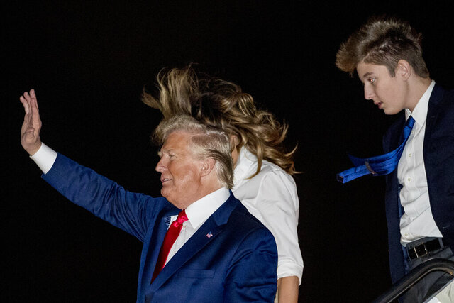 President Donald Trump, first lady Melania Trump and their son Barron Trump arrive at Palm Beach International Airport at West Palm Beach, Fla., Friday, Dec. 20, 2019. (AP Photo/Andrew Harnik)