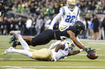 Oregon running back Tony Brooks-James (20), recovers a fumble on a punt return from UCLA defensive back Adarius Pickett (6), at the beginning of the  second quarter during an NCAA college football game in Eugene, Ore., Saturday, Nov. 3, 2018 (AP Photo/Thomas Boyd)
