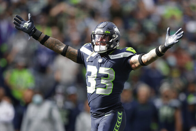 Seattle Seahawks strong safety Jamal Adams (33) reacts to a play against the Tennessee Titans during the second half of an NFL football game, Sunday, Sept. 19, 2021, in Seattle. (AP Photo/John Froschauer)