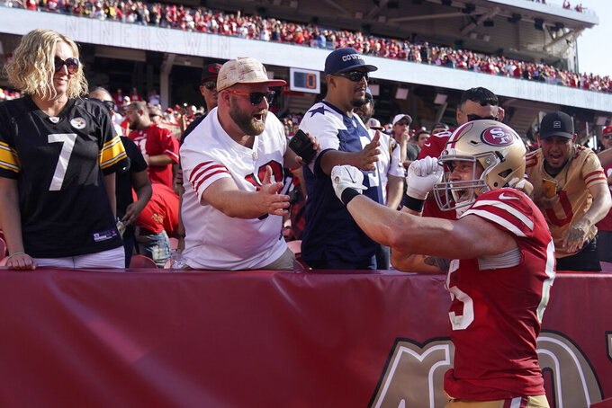 San Francisco 49ers tight end George Kittle (85) celebrates with fans after the 49ers defeated the Pittsburgh Steelers in an NFL football game in Santa Clara, Calif., Sunday, Sept. 22, 2019. (AP Photo/Tony Avelar)