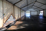 A view of the empty tent of a vaccination center after an arson attack on Saturday evening in Urrugne, southwestern France, Monday, July 19, 2021.Two Covid-19 vaccination centers were ransacked in less than 48 hours in France, over the weekend. (AP Photo/Bob Edme)
