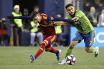 Seattle Sounders midfielder Cristian Roldan, right, fends off Real Salt Lake forward Jefferson Savarino during the first half of an MLS Western Conference semifinal playoff soccer match Wednesday, Oct. 23, 2019, in Seattle. (AP Photo/Ted S. Warren)