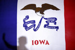 Democratic presidential candidate Sen. Elizabeth Warren, D-Mass., casts a shadow on an Iowa state flag as she speaks during a campaign event, Friday, Jan. 17, 2020, in Newton, Iowa. (AP Photo/Patrick Semansky)