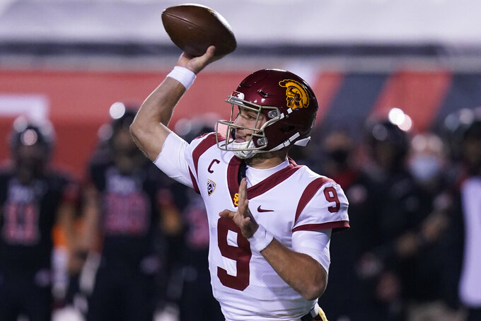 Southern California quarterback Kedon Slovis (9) throws a pass during the first half of the team's NCAA college football game against Utah on Saturday, Nov. 21, 2020, in Salt Lake City. (AP Photo/Rick Bowmer)
