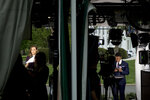 Television reporters prepare for live reporting along the driveway on the North Lawn of the White House, Thursday, April 18, 2019, in Washington. (AP Photo/Andrew Harnik)