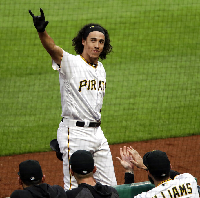 Pittsburgh Pirates' Cole Tucker takes a curtain call after hitting a two-run home run off San Francisco Giants starting pitcher Derek Holland for his first hit in his first Major League Baseball game in Pittsburgh, Saturday, April 20, 2019. (AP Photo/Gene J. Puskar)