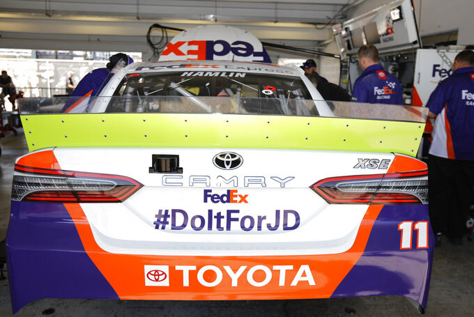 Denny Hamlin will honor JD Gibbs with a hashtag painted on his car for a NASCAR Cup Series auto race on Saturday, Nov. 16, 2019, at Homestead-Miami Speedway in Homestead, Fla. Gibbs past away earlier this year. (AP Photo/Terry Renna)