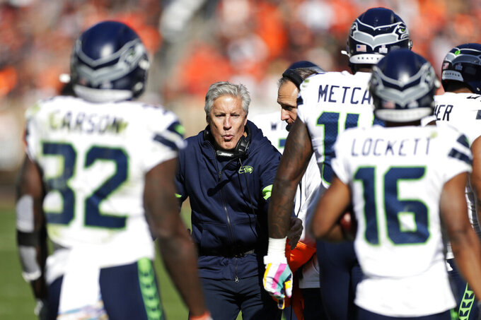 Seattle Seahawks head coach Pete Carroll, center, celebrates a touchdown during the second half of an NFL football game against the Cleveland Browns, Sunday, Oct. 13, 2019, in Cleveland. (AP Photo/Ron Schwane)