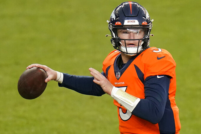 Denver Broncos quarterback Drew Lock (3) throws against the Las Vegas Raiders during the first half of an NFL football game, Sunday, Jan. 3, 2021, in Denver. (AP Photo/Jack Dempsey)