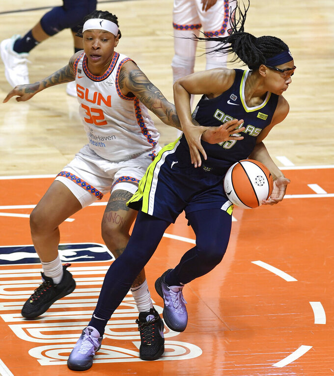Connecticut Sun forward Emma Cannon commits the foul on Dallas Wings guard Alisha Gray during the seconds half of a WNBA basketball game Tuesday, June 22, 2021 at Mohegan Sun Arena in Uncasville, Conn. (Sean D. Elliot/The Day via AP)