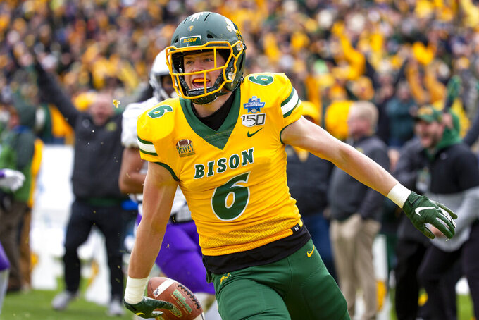 North Dakota State safety James Hendricks (6) smiles after scoring on a fake field goal attempt during the first half of the FCS championship NCAA college football game against James Madison, Saturday, Jan. 11, 2020, in Frisco, Texas. (AP Photo/Sam Hodde)