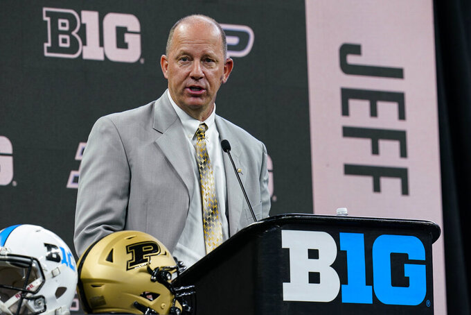 FILE - Purdue head coach Jeff Brohm talks to reporters during an NCAA college football news conference at the Big Ten Conference media days in Indianapolis, in this Friday, July 23, 2021, file photo. Brohm named Jack Plummer the starting quarterback late last week, partially because of his mobility. But Brohm also made it clear he's still willing to make a change -- if he doesn't get the kind of play he expects.  (AP Photo/Michael Conroy, File)