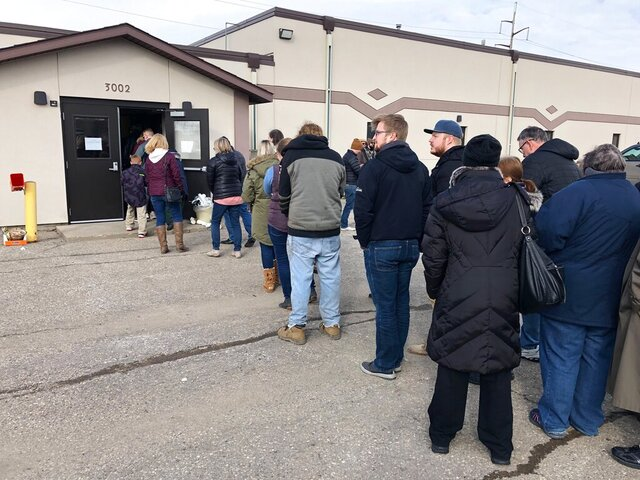 Voters wait in line for the North Dakota Democratic presidential caucus outside a union hall in Fargo, N.D., on Tuesday, March 10, 2020. The strong turnout forced party officials to bring in extra equipment and volunteers. (AP Photo/Dave Kolpack)