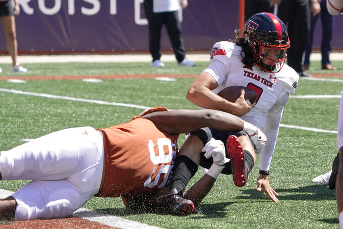 Texas Tech quarterback Henry Colombi (3) is sacked by Texas defensive lineman Alfred Collins (95) during the second half of an NCAA college football game on Saturday, Sept. 25, 2021, in Austin, Texas. (AP Photo/Chuck Burton)