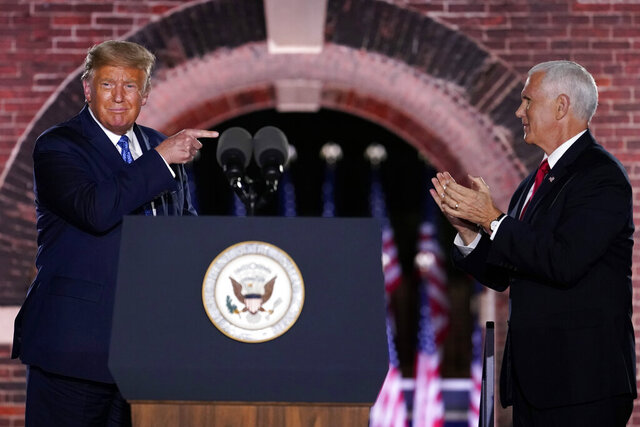 President Donald Trump joins Vice President Mike Pence on stage after Pence spoke on the third day of the Republican National Convention at Fort McHenry National Monument and Historic Shrine in Baltimore, Wednesday, Aug. 26, 2020. (AP Photo/Andrew Harnik)