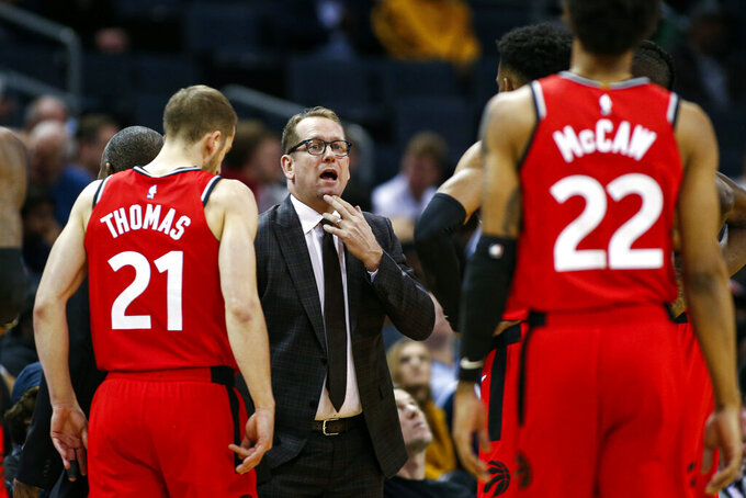 FILE - In this Jan. 8, 2020, file photo, Toronto Raptors coach Nick Nurse, center, gathers his team during a timeout in the first half of an NBA basketball game against the Charlotte Hornets in Charlotte, N.C. The defending NBA champions enter the NBA restart sitting second in the Eastern Conference. (AP Photo/Nell Redmond, File)