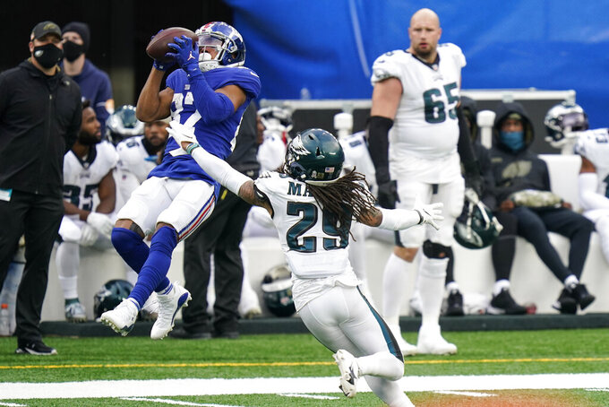New York Giants' Sterling Shepard (87) catches a pass in front of Philadelphia Eagles' Avonte Maddox (29) during the second half of an NFL football game Sunday, Nov. 15, 2020, in East Rutherford, N.J. (AP Photo/Seth Wenig)